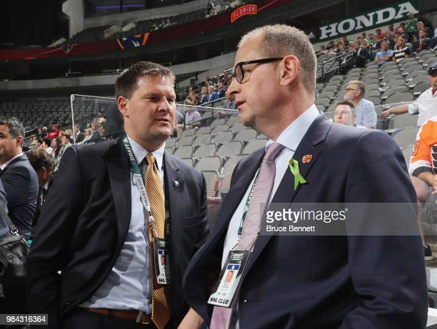 Jason Boterill and Brad Treliving attend the 2018 NHL Draft at American Airlines Center on June 23, 2018 in Dallas, Texas.
