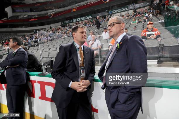 Jason Botterill of the Buffalo Sabres and Brad Treliving of the Calgary Flames chat during the 2018 NHL Draft at American Airlines Center on June 23,...