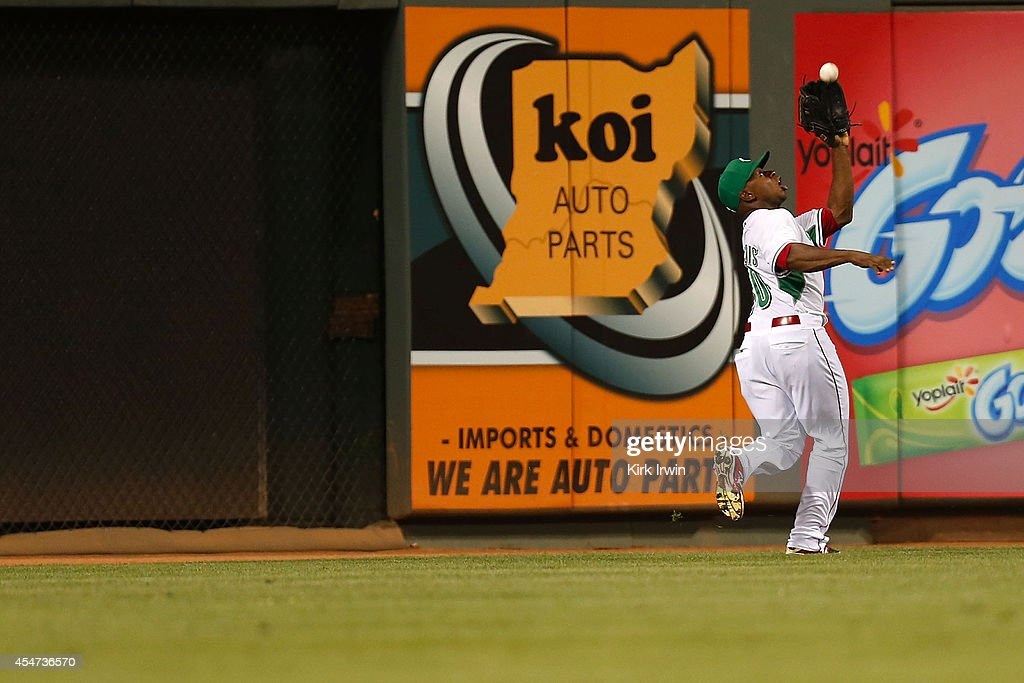 Jason Bourgeois #30 of the Cincinnati Reds catches a fly ball hit by Wilmer Flores #4 of the New York Mets during the ninth inning at Great American Ball Park on September 5, 2014 in Cincinnati, Ohio. New York defeated Cincinnati 14-5.