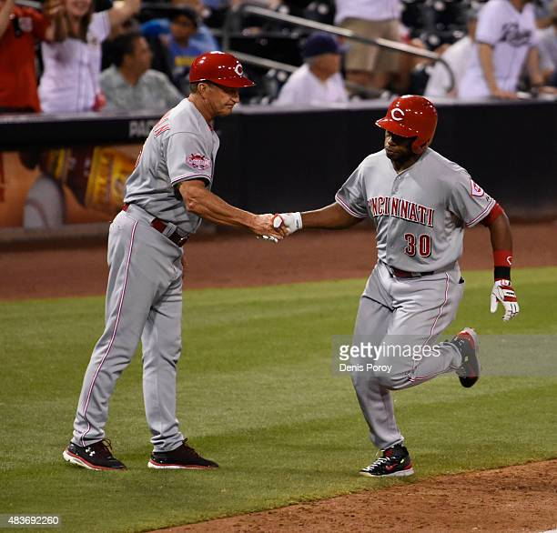 Jason Bourgeois of the Cincinnati Reds right is congratulated by Jim Riggleman after hitting a tworun home run during the ninth inning of a baseball...