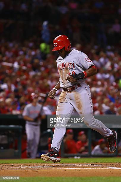 Jason Bourgeois of the Cincinnati Reds scores a run against the St Louis Cardinals in the first inning at Busch Stadium on September 21 2015 in St...