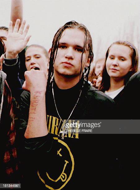 Jason Brady a fan of grunge rock star Kurt Cobain shows his arm bearing the mispelled phrase Kurdt Lives Brady was one of about 5000 fans of the lead...