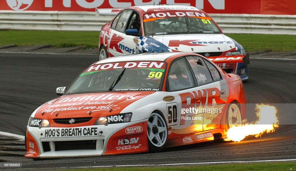 Jason Bright spits flames from the exhaust of his : News Photo