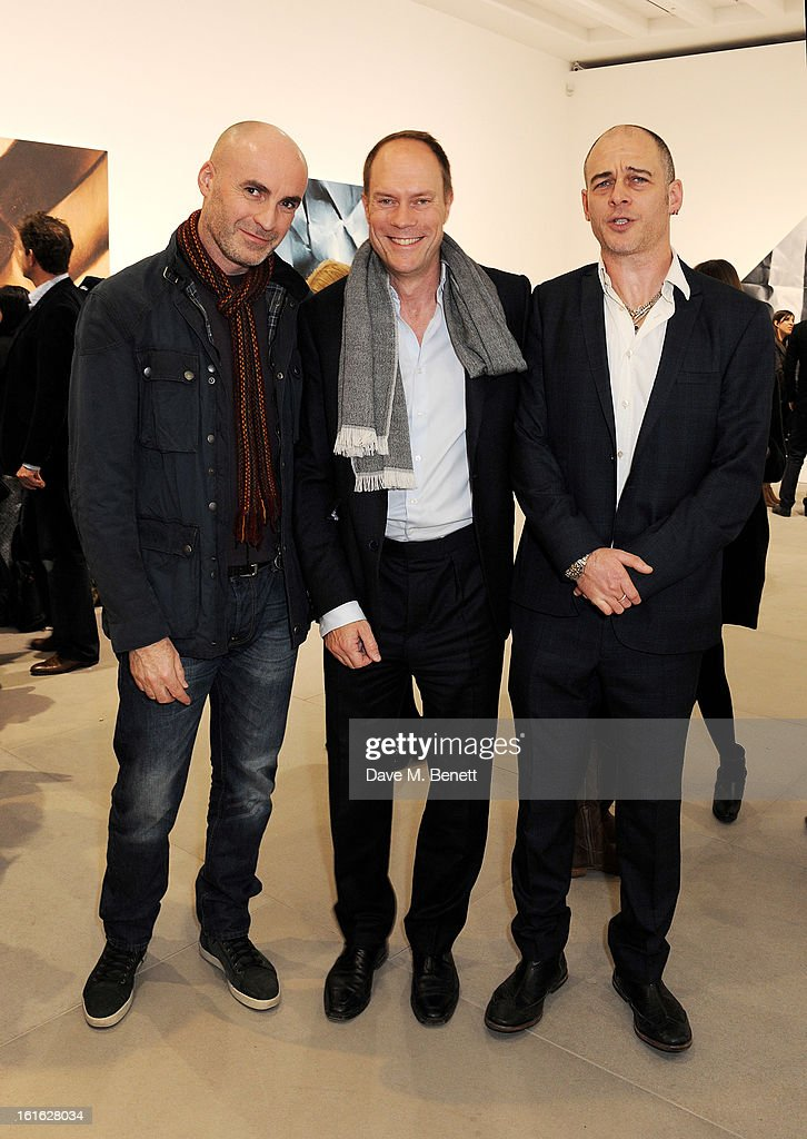 Jason Brooks, Harry Blaine and Dinos Chapman attend a private view of 'Mat Collishaw: This Is Not An Exit' at Blaine/Southern Gallery on February 13, 2013 in London, England.