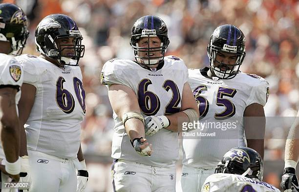 Jason Brown and Mike Flynn of the Baltimore Ravens stand on the field during the NFL game against the Cleveland Browns at Cleveland Browns Stadium...