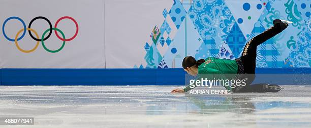 US Jason Brown falls as he performs in the Men's Figure Skating Team Free Program at the Iceberg Skating Palace during the Sochi Winter Olympics on...