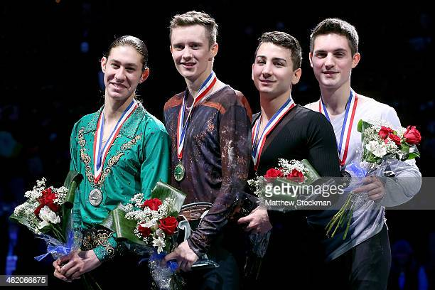Jason Brown Jeremy Abbott Max Aaron and Joshua Farris pose for photographers on the medals podium after the men's competition during the Prudential...