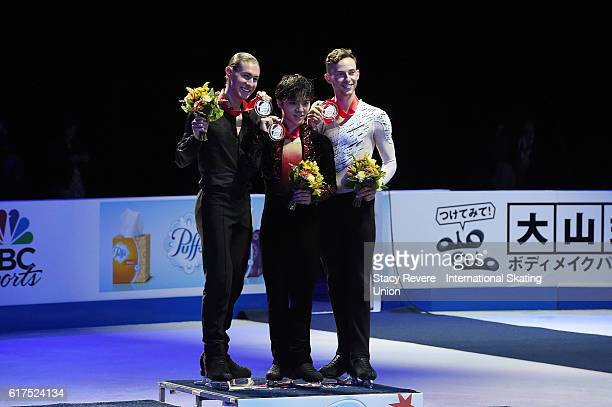Jason Brown of the United States Shoma Uno of Japan and Adam Rippon of the United States pose with the medals on day 3 of the Grand Prix of Figure...