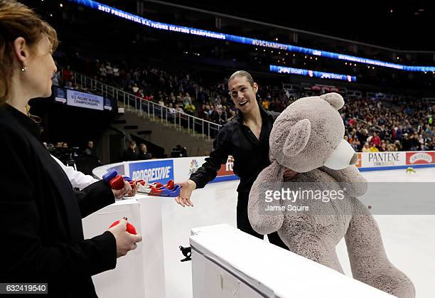 Jason Brown skates off the ice holding a giant teddy bear after competing in the Men's Free Skate program during the 2017 US Figure Skating...