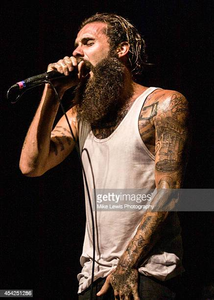 Jason Butler of Letlive performs on stage at Motorpoint Arena on August 26 2014 in Cardiff United Kingdom