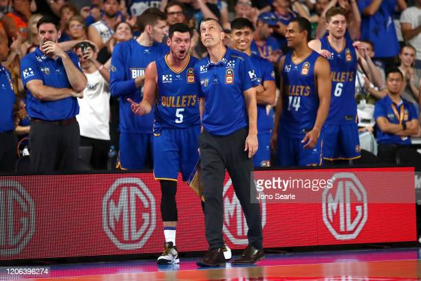 Jason Cadee and Bullets coach Andrej Lemanis talk during the round 20 NBL match between the Brisbane Bullets and the Cairns Taipans at Nissan Arena...