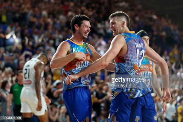 Jason Cadee and Will Magnay of the Bullets celebrate winning the round 18 NBL match between the Brisbane Bullets and Melbourne United at Nissan Arena...