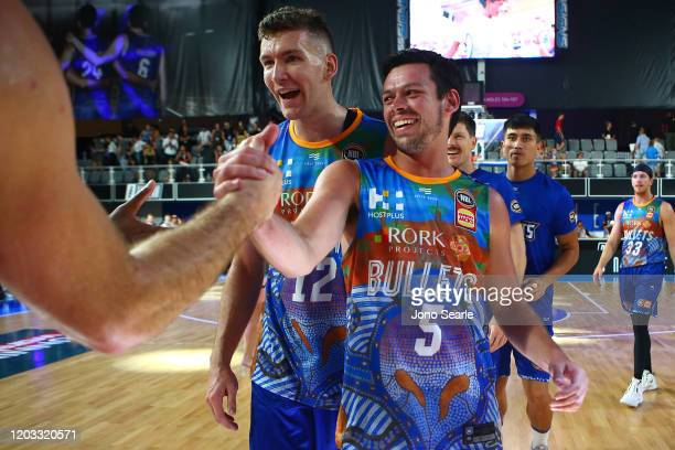 Jason Cadee celebrates the win with team mate 1 and team mates during the round 18 NBL match between the Brisbane Bullets and Melbourne United at...