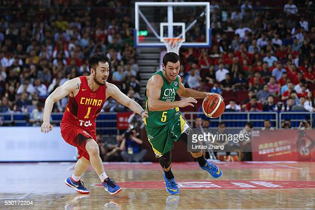 Jason Cadee of Australia looks to pass against Sui Ran of China during Internationl Basketball Challenge match between the Chinese National Team and...