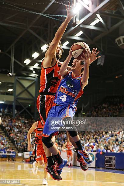 Jason Cadee of the 36ers is bocked by Matt Knight of the Wildcats during the round seven NBL match between the Adelaide 36ers and the Perth Wildcats...
