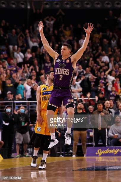 Jason Cadee of the Bullets looks dejected as Shaun Bruce of the Kings celebrates victory during the round 21 NBL match between Sydney Kings and...