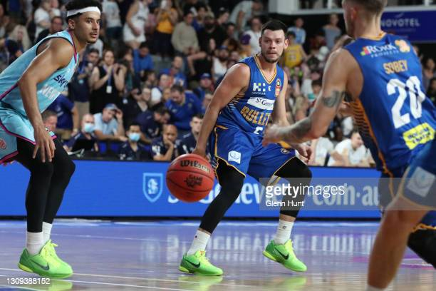Jason Cadee of the Bullets makes a pass to Nathan Sobey of the Bullets during the round 11 NBL match between the Brisbane Bullets and the New Zealand...