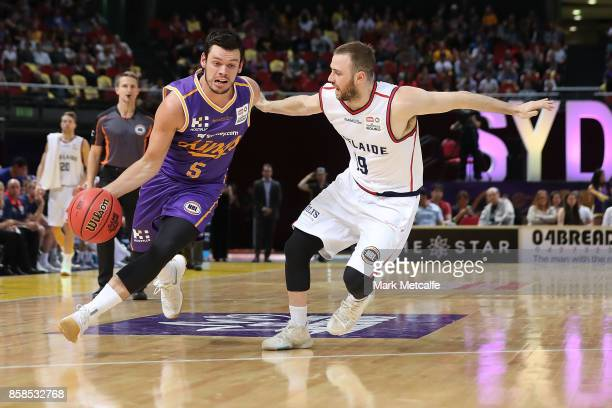 Jason Cadee of the Kings drives past Adam Doyle of the 36ers during the round one NBL match between the Sydney Kings and the Adelaide 36ers at Qudos...