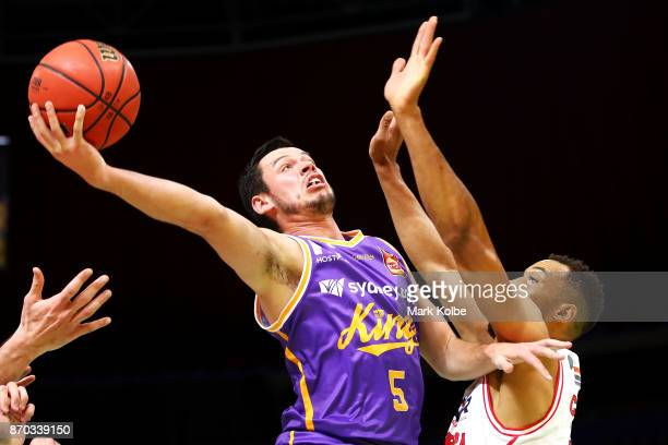 Jason Cadee of the Kings drives to the basket under pressure from Demitrius Conger of the Hawks during the round five NBL match between the Sydney...