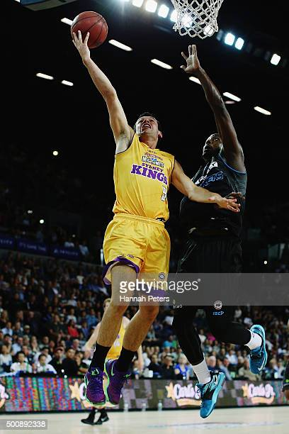 Jason Cadee of the Kings lays the ball up as Cedric Jackson of the Breakers defends during the round 10 NBL match between the New Zealand Breakers...