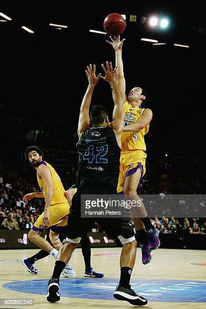 Jason Cadee of the Kings lays the ball up as Tai Wesley of the Breakers defends during the round 10 NBL match between the New Zealand Breakers and...
