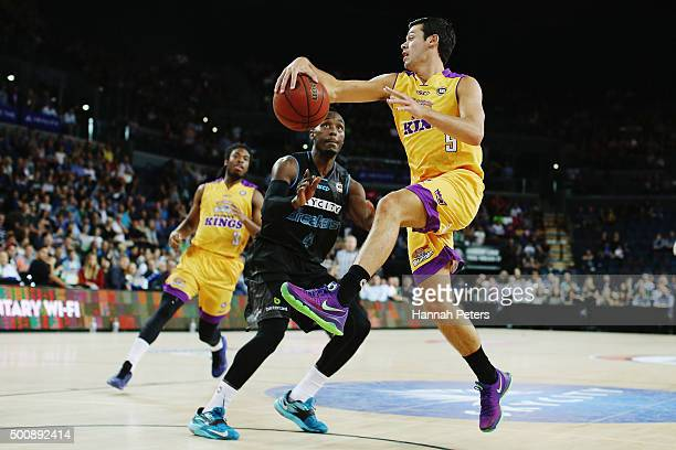 Jason Cadee of the Kings passes the ball back around Cedric Jackson of the Breakers during the round 10 NBL match between the New Zealand Breakers...