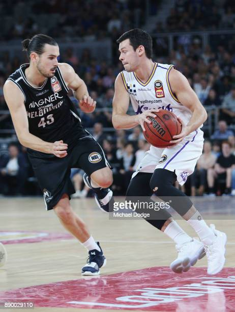 Jason Cadee of the Kings runs with the ball from Chris Goulding of United during the round nine NBL match between Melbourne United and the Sydney...