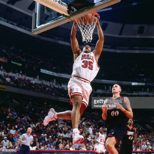 Jason Caffey of the Chicago Bulls dunks during a game played on November 1 1997 at the First Union Arena in Philadelphia Pennsylvania NOTE TO USER...
