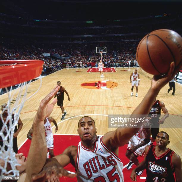 Jason Caffey of the Chicago Bulls shoots a layup during a game played on November 1 1997 at the First Union Arena in Philadelphia Pennsylvania NOTE...