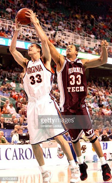 Jason Cain of the Virginia Cavliers battles Coleman Collins of the Virginia Tech Hokies for a rebound during day 1 of the Atlantic Coast Conference...