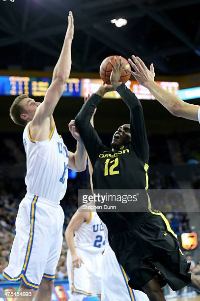Jason Calliste of the Oregon Ducks shoots against David Wear of the UCLA Bruins at Pauley Pavilion on February 27, 2014 in Los Angeles, California....
