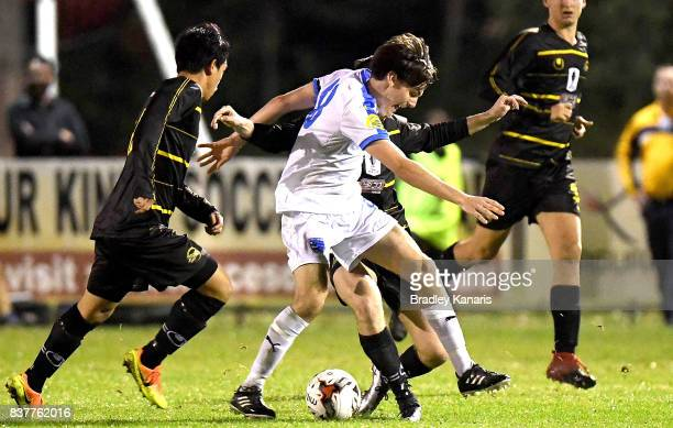 Jason Campbell of Gold Coast City takes on the defence during the FFA Cup round of 16 match between Moreton Bay United and Gold Coast City at Wolter...