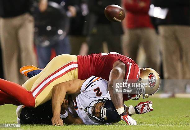 Jason Campbell of the Chicago Bears fumbles the ball as he is sacked by Ahmad Brooks of the San Francisco 49ers in the third quarter of the game at...