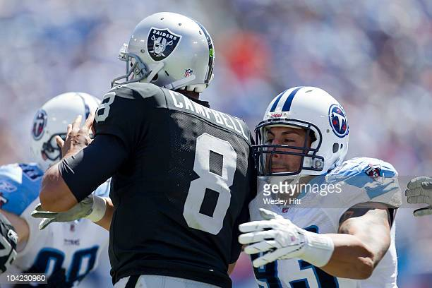 Jason Campbell of the Oakland Raiders is hit by Jason Babin of the Tennessee Titans during the season opener at LP Field on September 12 2010 in...