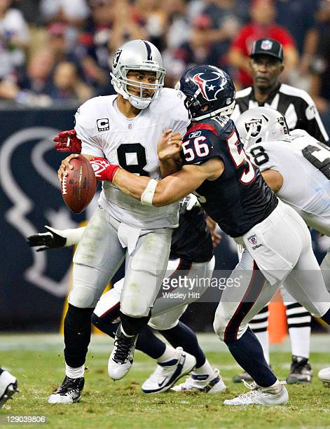 Jason Campbell of the Oakland Raiders is sacked by Brian Cushing of the Houston Texans at Reliant Stadium on October 9, 2011 in Houston, Texas. The...