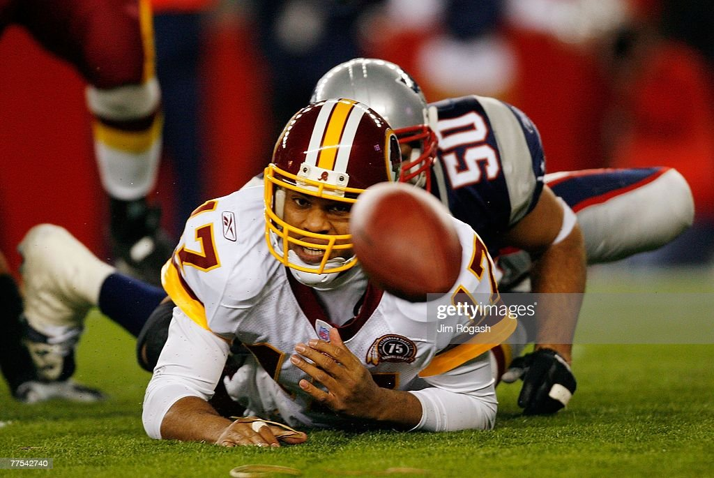Jason Campbell #17 of the Washington Redskins fumbles the ball after he is sacked by Mike Vrabel #50 of the New England Patriots on October 28, 2007 at Gillette Stadium in Foxboro, Massachusetts. The Patriots defeated the Redskins 52-7.