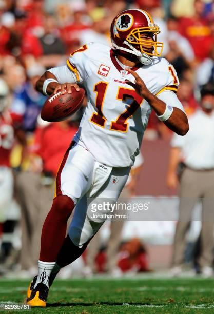 Jason Campbell of the Washington Redskins looks to throw the ball against the Arizona Cardinals in the fourth quarter at FedEx Field September 21...