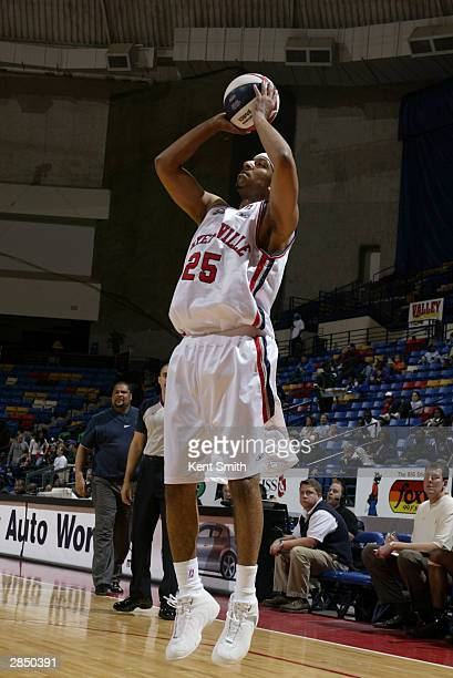 Jason Capel of the Fayetteville Patriots shoots against the Columbus Riverdragons during the game at Crown Coliseum on December 12, 2003 in...