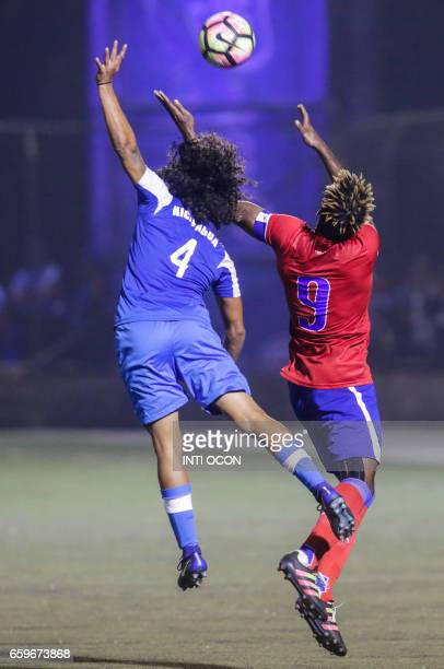 Jason Casco from Nicaragua fights for the ball with Kervens Fils Belfort of the Haiti National Football Team during the second match of Nicaragua vs...
