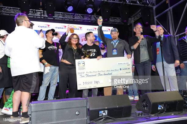Jason Casey of Mister Dips accepts the people's choice award from Rachael Ray and Randy Fisher onstage at the Blue Moon Burger Bash presented by Pat...