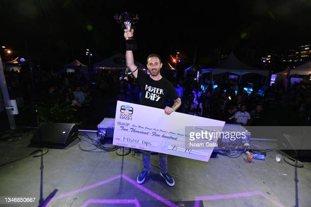 Jason Casey of Mister Dips accepts the people's choice award onstage at the Blue Moon Burger Bash presented by Pat LaFrieda Meats hosted by Rachael...