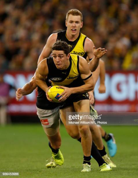Jason Castagna of the Tigers and Ciaran Byrne of the Blues in action during the 2018 AFL round 01 match between the Richmond Tigers and the Carlton...