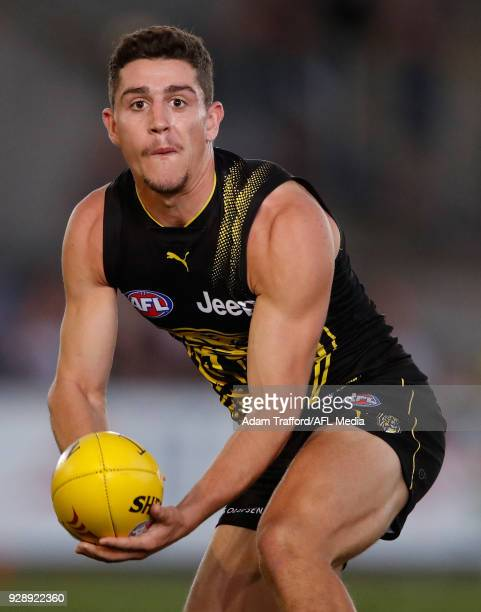 Jason Castagna of the Tigers handpasses the ball during the AFL 2018 JLT Community Series match between the Richmond Tigers and the North Melbourne...