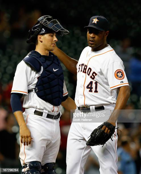 Jason Castro and Jose Veras of the Houston Astros celebrate after defeating the Seattle Mariners 32 at Minute Maid Park on April 23 2013 in Houston...