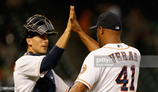 Jason Castro and Jose Veras of the Houston Astros celebrate at the mound after defeating the Kansas City Royals 6-5 at Minute Maid Park on May 20,...