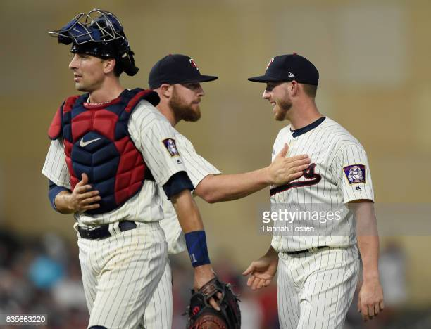 Jason Castro Chris Gimenez and Mitch Garver of the Minnesota Twins celebrate winning against the Arizona Diamondbacks after the game on August 19...