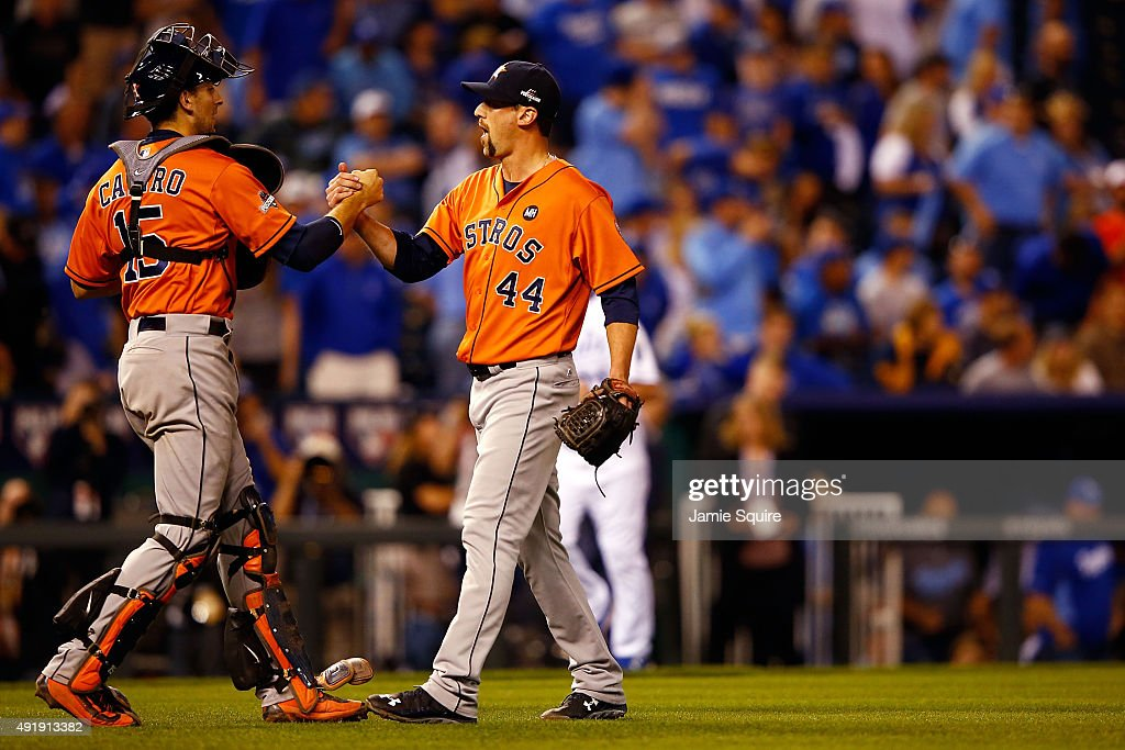 Jason Castro #15 of the Houston Astros celebrates with Luke Gregerson #44 of the Houston Astros after defeating the Kansas City Royals in game one of the American League Division Series at Kauffman Stadium on October 8, 2015 in Kansas City, Missouri. The Houston Astros defeat the Kansas City Royals with a score of 5 to 2.
