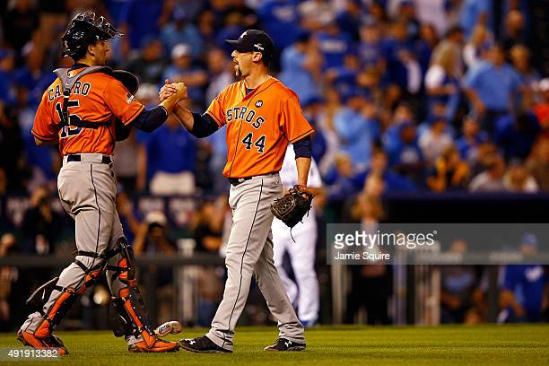 Jason Castro of the Houston Astros celebrates with Luke Gregerson of the Houston Astros after defeating the Kansas City Royals in game one of the...