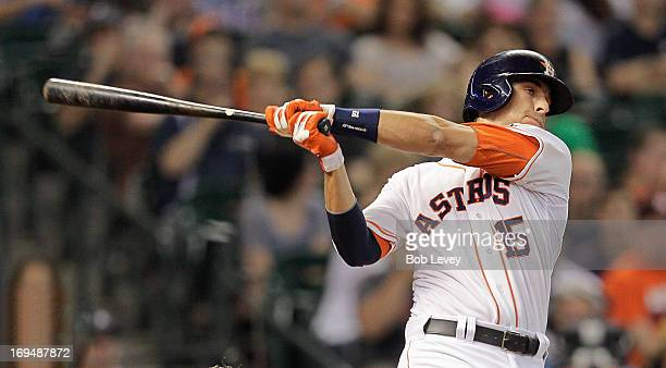 Jason Castro of the Houston Astros hits a home run to right field in the first inning against the Oakland Athletics at Minute Maid Park on May 25...