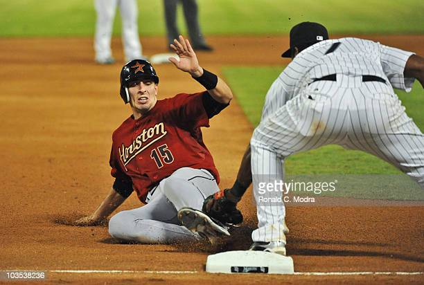 Jason Castro of the Houston Astros is out at third base during a MLB game against the Florida Marlins at Sun Life Stadium on August 20 2010 in Miami...